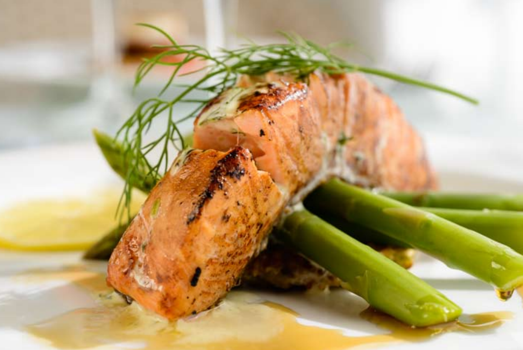 Pan-seared maple-glazed ocean trout, leek pancake, braised fennel, pan-tossed asparagus, and dill cream